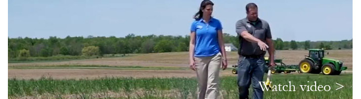 soil health two people walking in field watch video